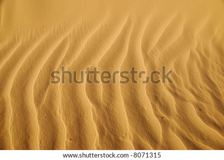 Close-up to show details and structure of the sand.