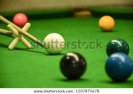 Close up to snooker player. Snooker ball on table view. Sport background. #1107875678