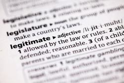 Close up to the dictionary definition of Legitimate