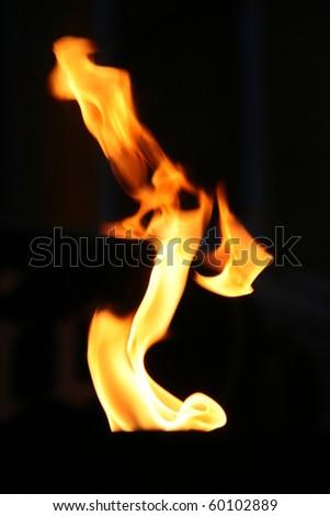 Close-up tongue of flame: dancing woman