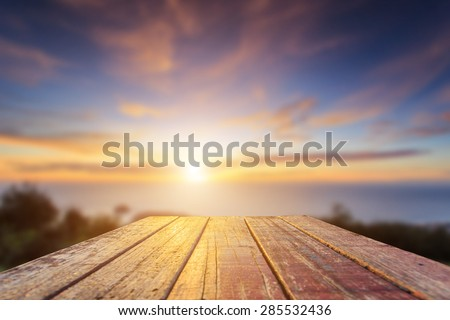 wooden table close up. detail · close up top of old wooden table with blur sunset background #285532436 5