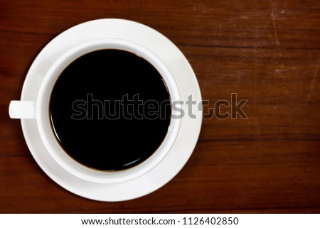 close up top view espresso coffee with white cup and saucer on wooden table background .