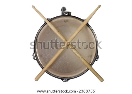 close up top view of a snare drum with drum sticks