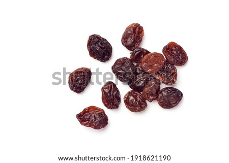 Close-up top view of Raisins isolated on white background. Stock photo ©