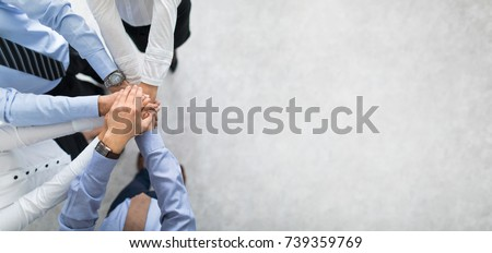 Close up top view of young business people putting their hands together. Stack of hands. Unity and teamwork concept. Stockfoto ©