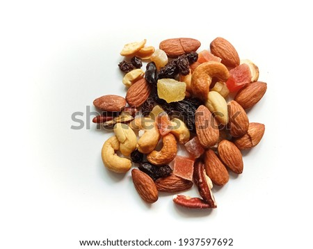 Close-up top view photo of mixed nuts and tropical dry fruits isolated on white background for decoration and design. Foto d'archivio ©