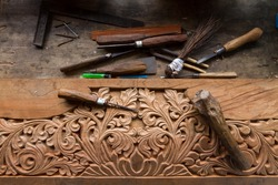 Close up top view set of carpenters tool on the hand made engraving, carving wood