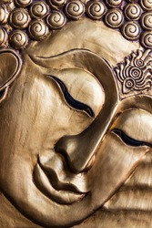 Close up Traditional Thai style Lord Buddha's face wood carving. Thailand