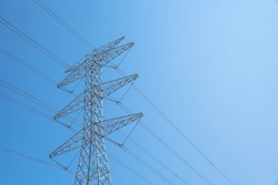 Close-up transmission towers (power tower, electricity pylon, steel lattice tower) cloud blue sky in Houston, Texas, US. Texture high voltage pillar, overhead power line, industrial background.