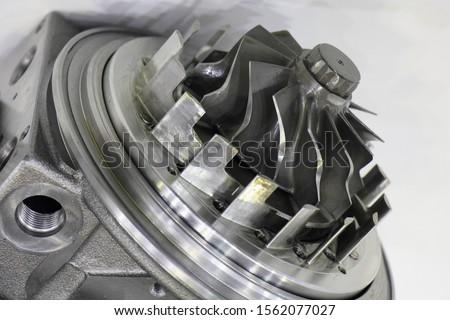 Photo of  Close up turbine propeller of new car turbo motor, engine tuning