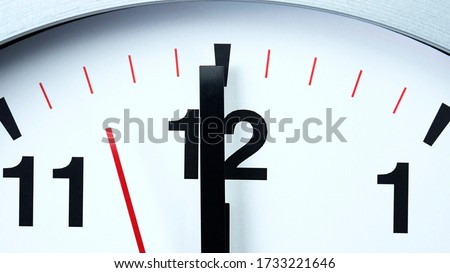Close up Twelve o'clock Gray wall clock beginning of time 12.00 pm. , Concept It is 100 Seconds to Midnight. Stock photo ©