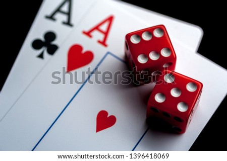 Close-up - Two aces, playing cards and red gaming dices on black table. Casino, gambling game chance concept #1396418069