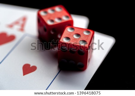 Close-up - Two aces, playing cards and red gaming dices on black table. Casino, gambling game chance concept #1396418075