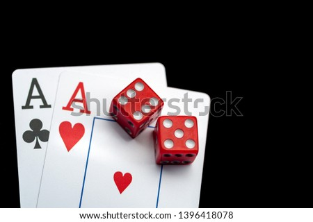 Close-up - Two aces, playing cards and red gaming dices on black table. Casino, gambling game chance concept #1396418078