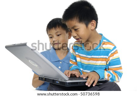 Close up two brother using computer