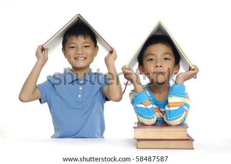 Close up two children with books