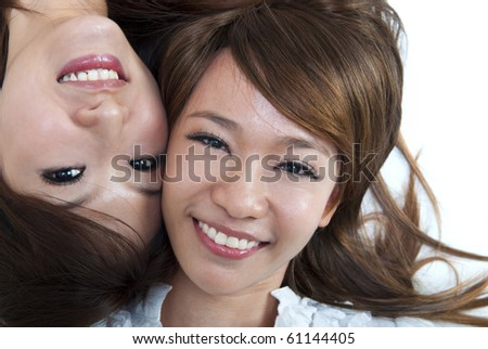 Close up two cute girls lying on floor