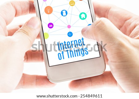 Close up Two hand holding smartphone with Internet of things word and icons, Digital Marketing concept #254849611