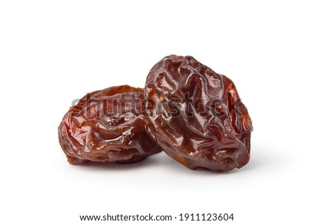 Close-up two Raisins isolated on white background. Clipping path. Stock photo ©