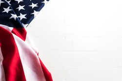 Close up United States of America flag on white wooden background. USA Independence day, 4 July.