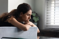 Close up upset thoughtful woman with closed eyes lying on couch alone, lost in thoughts, thinking about personal problems, frustrated unhappy young female crying, break up with boyfriend or divorce