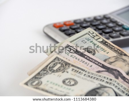 Close up 20 US dollars bills and calculator in soft background. White background with copy space. Save little by little concept. Save little by little concept. Collect money for saving. #1113684380
