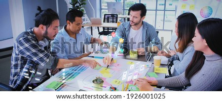 Close up ux developer and ui designer use augmented reality app brainstorming about mobile interface wireframe design on desk at modern office.Creative digital development agency Foto stock ©