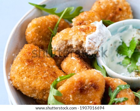 Close-up Vegetarian Nuggets, Vegan Dipping Sauce and rocket leaves on a light background, space for text, selective focus. Healthy and delicious vegan food. Diet, Protein Vegetarian Meals concept.