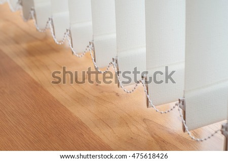 Close up vertical blind for the office room decoration. Design of curtain bright for interior office. Modern style of sun blinds for office and abstract background. Stock photo ©