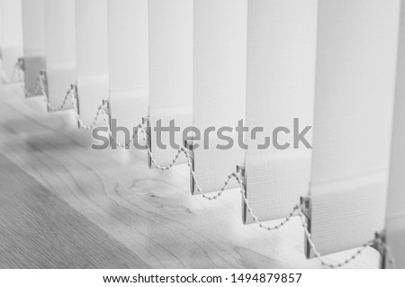 Close up vertical blind in black and white tone for the office room decoration. Design of curtain bright for interior office. Modern style of sun blinds for office and abstract background. Stock photo ©