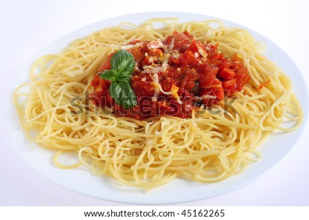 Close-up vertical view of Spaghetti al Pomodoro - spaghetti with tomato and vegetable sauce, topped with grated parmesan - a traditional Italian dish.