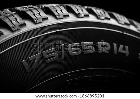 Photo of  close up view for a tyre overall diameter label. tire with r14 radius for cars.