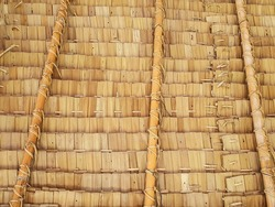 Close-up view from the southern side of a traditional thatched roof in a rural village. That thatched roof can be sunproof and rainproof. And good ventilation, popular to decorate restaurants, cafe.