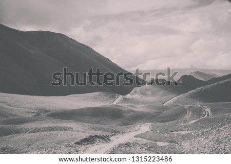 Close up view mountains scenes in national park Dombai, Caucasus, Russia, Europe. Summer landscape, sunshine weather, dramatic blue sky and sunny day #1315223486