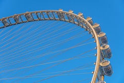 Close up view of a Ain Dubai ferris wheel capsules in blue skies located at Bluewaters Island with many capsules installed in Dubai, UAE