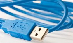 Close-up view of a blue USB cable