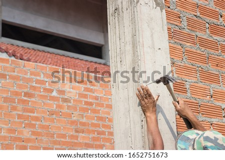 Close up view of a brick wall on a construction site, Construction concept.