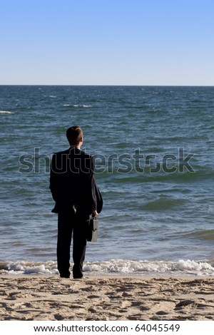 Close up view of a business man in a dark suit .