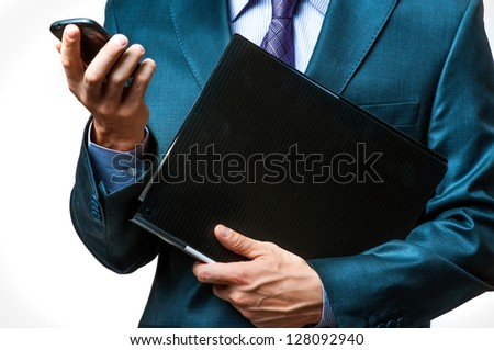 Close up view of a businessman hands using smartphone and with folder of documents