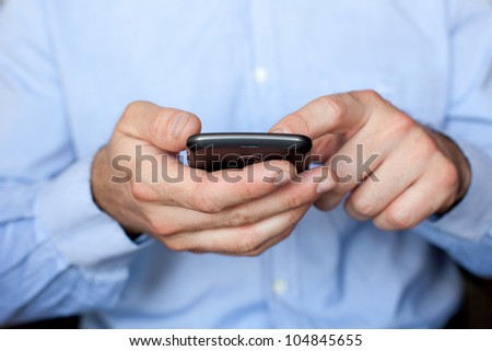 Close up view of a businessman using a smartphone