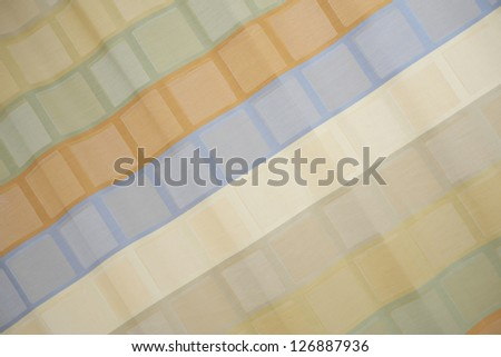 Close up view of a colorful cotton fabric.