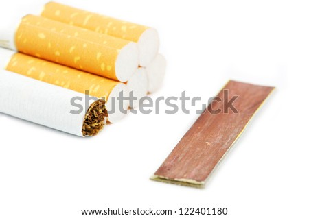 Close up view of a few cigarettes on a white background