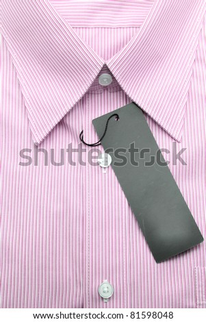 Close up view of a generic line pattern red business shirt with a blank label