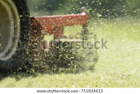 Close-up view of a lawn mower in action #751834615