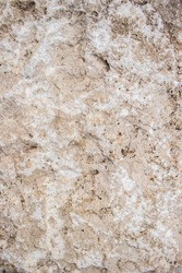 Close up view of a lightbrown stone texture with rugged surface. Space for copy.
