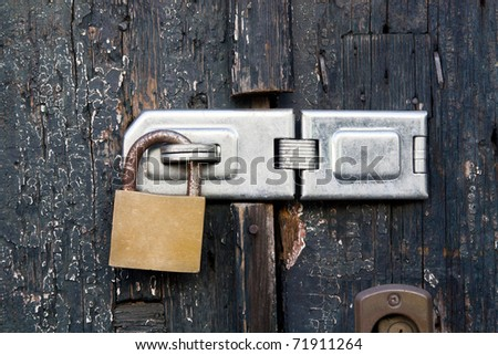 Close up view of a lock on old wooden door.