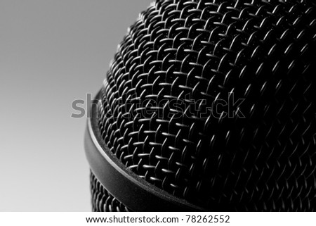 Close-up view of a modern black microphone
