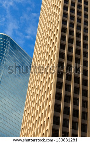 Close up view of a pair of downtown skyscrapers.