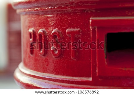 Close-up view of a red postbox, toned image.