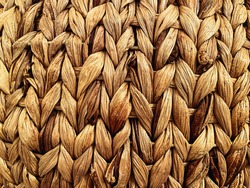 close-up view of a straw basket. Detail on the lines. Handmade product. Texture effect. Retro furniture and decorations